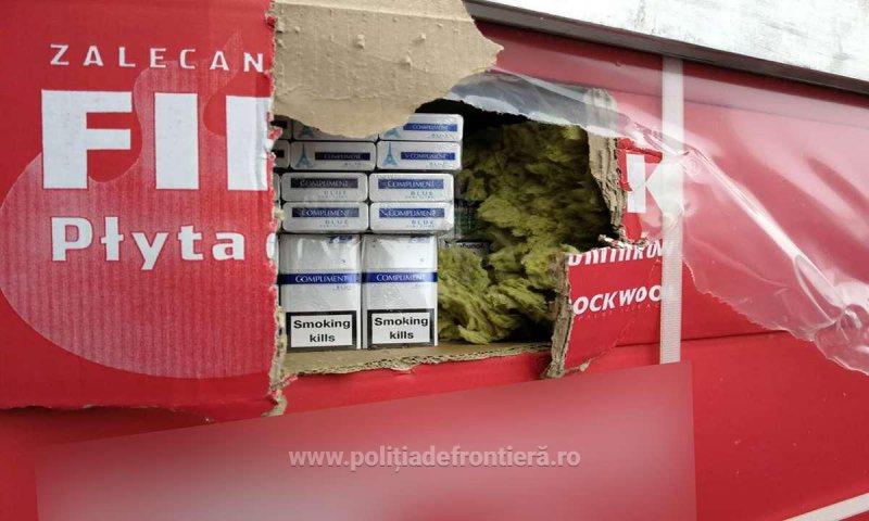 CONTRABANDĂ: Mii de baxuri cu țigări ascunse în colete cu materiale de construcții