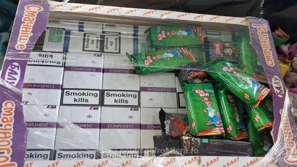 Țigări de contrabandă găsite în cutii cu prăjituri